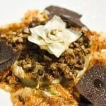 Flor de alcachofa con naranjas y aceite de trufa