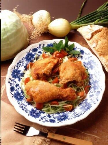 Muslitos de pollo fritos con tomates cherry