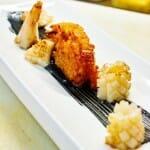 Arroz frito con calamares y ajo, aceite-tinta