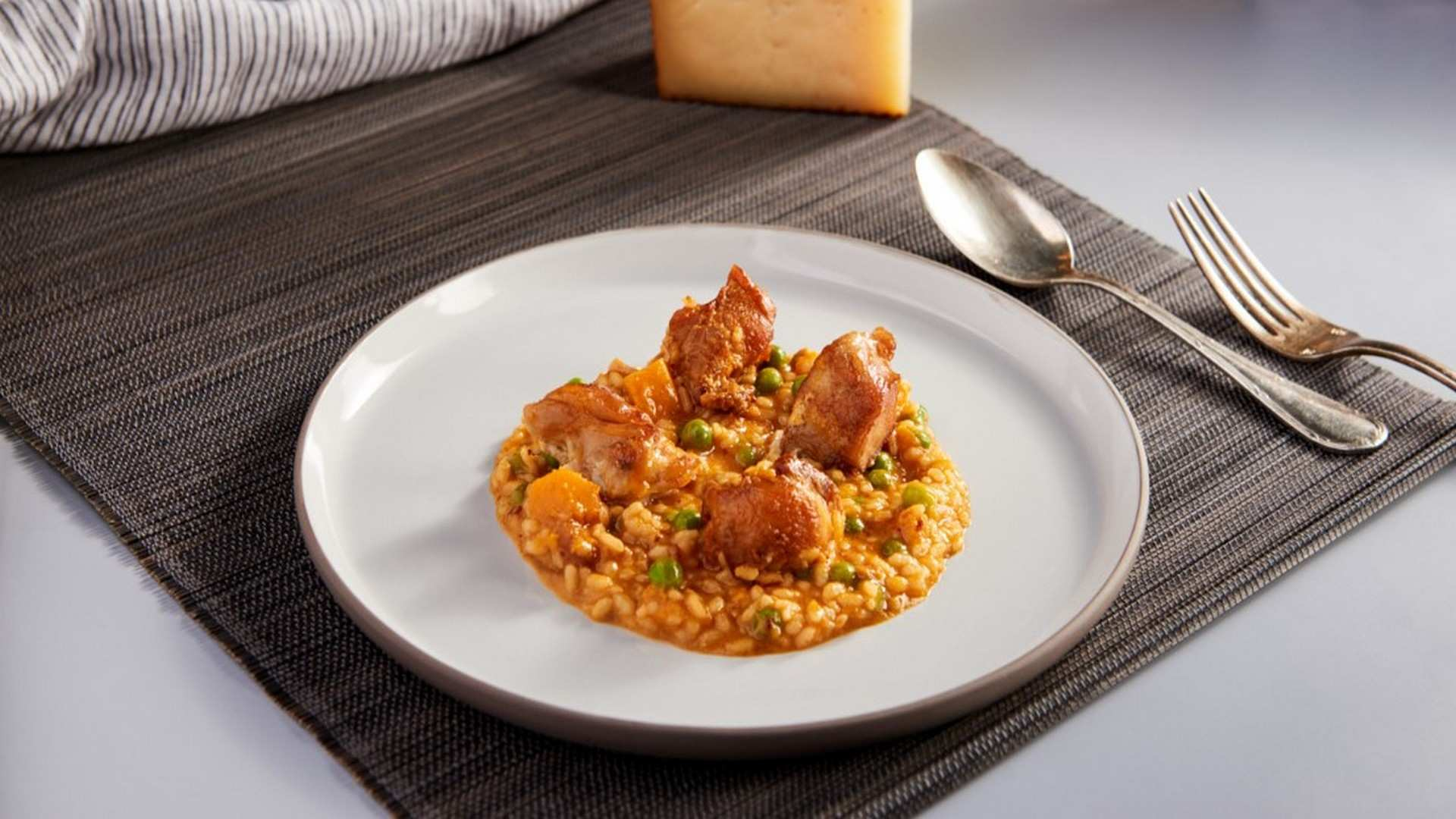 Receta de Risotto de carne de conejo con calabaza y guisantes
